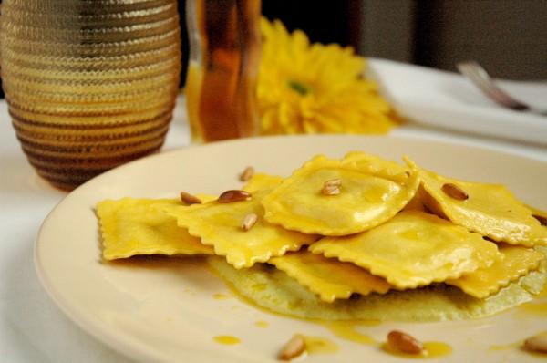 Ravioli di cernia in Mousse di Verza e Colatura di Alici con Pinoli tostati e profumo di Arancia